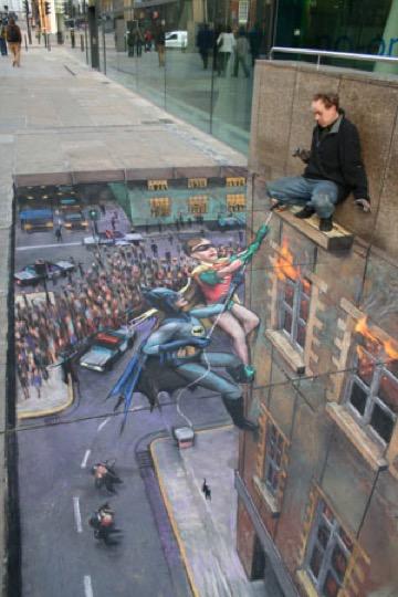 Pintura en acera que simula la cornisa de un edificio